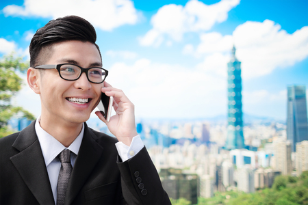 business man speak phone in the taipei