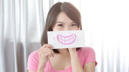 woman take smile happily tooth card in the home