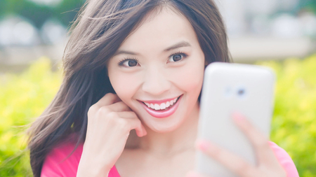 beauty woman selfie and smile happily in the park
