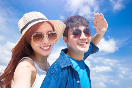 couple selfie happily with the blue sky Stock Photo