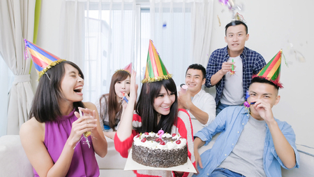 people smile happily with birthday party in the home