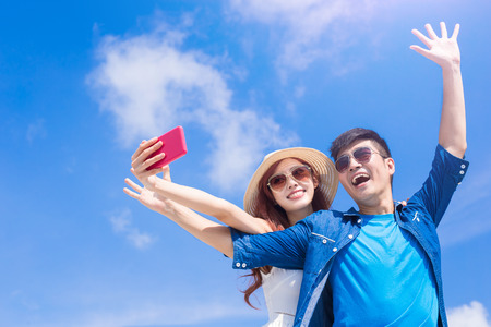 couple selfie happily with the blue sky Foto de archivo