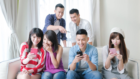 young people use phone and smile happily Stock Photo