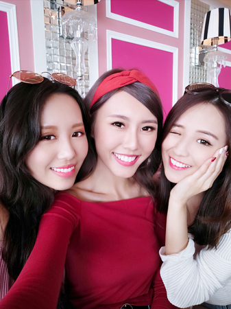 three beauty woman selfie happily in the restaurant Stock Photo