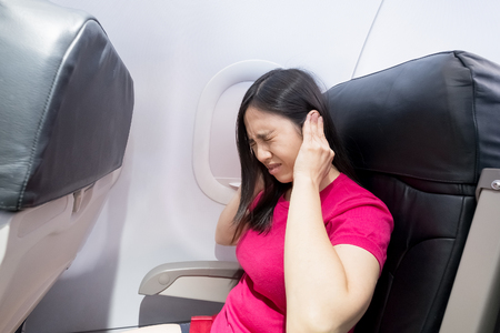 middle aged woman feel tinnitus in the airplanes Фото со стока - 93277407