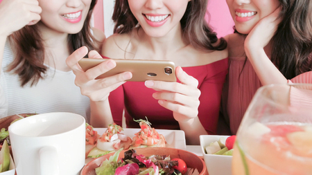 women take picture with food in the restaurant Stock Photo - 93213241