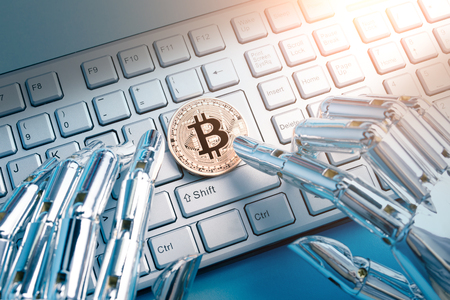 Robot hand with bitcoin on the table