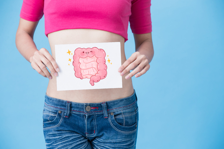 woman with health intestine concept on the blue background