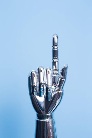 robot hand show something on the blue background