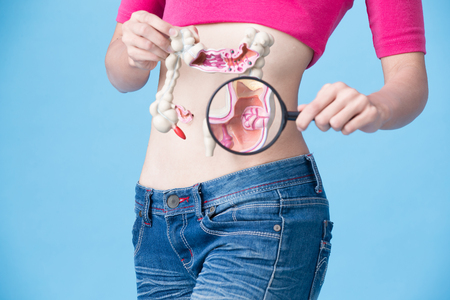 woman with colorectal cancer concept on the blue backgorund