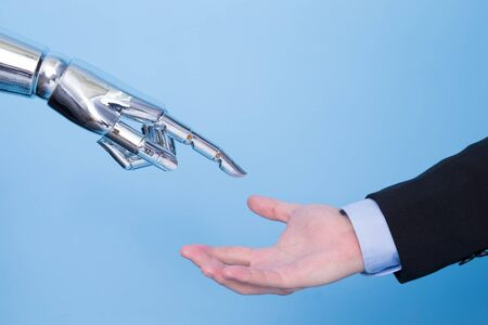 touch with robot hand on the blue bakcgorund Stock Photo