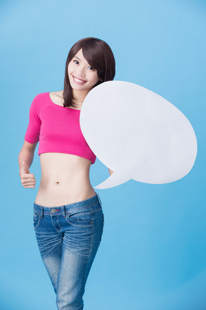 woman take speech bubble near waist on the blue background