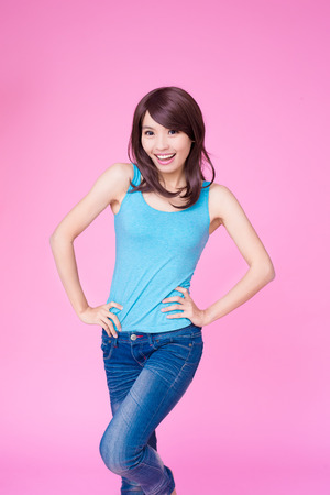 woman smile happily to you on the pink background