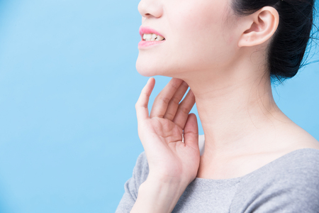 women with thyroid gland problem on the blue background