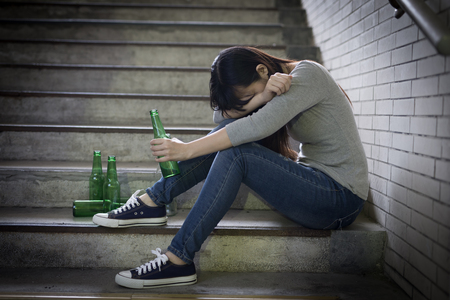 depressed woman feel upset with alcoholism problem and sit in underground road