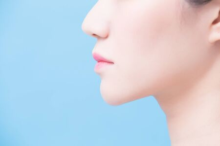 close up of woman chin on the blue background Standard-Bild