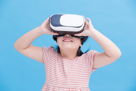 cute girl wear vr on the blue background