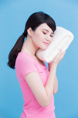 woman with clean towels on the blue background