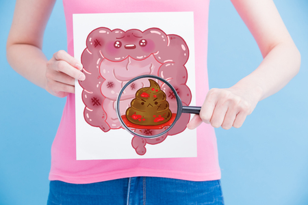 woman take unhealth intestine billboard and magnifying on the blue background