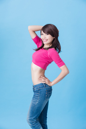 woman smile happily with slim waist on the blue background