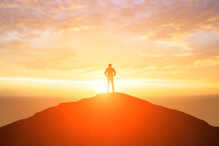silhouette of business man look somewhere on the mountain Stock Photo