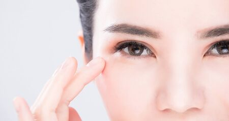 close up of beauty woman eye on the gray background