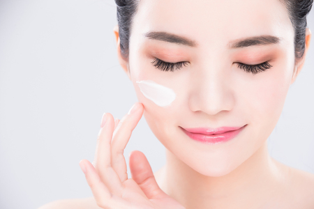 woman close eyes and touch face with beauty skin care concept Stockfoto