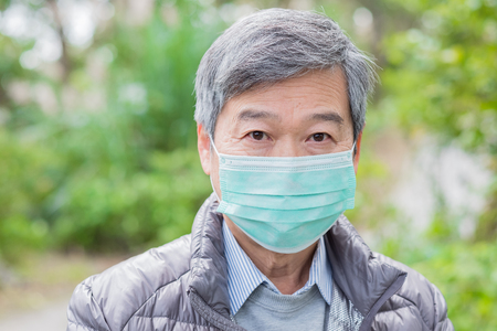 old couple get cold and wear mask outdoor