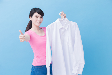 house take clean shirt and thumb up on the blue background