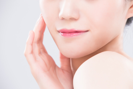 close up of beauty woman lip on the gray backgorund 스톡 콘텐츠