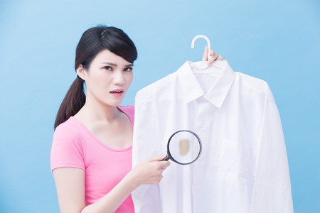 house take clean shirt and magnifying on the blue background