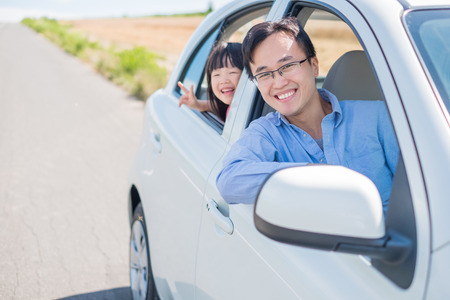 man with daughter drive car in Furano