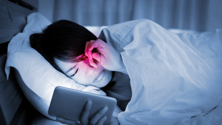 woman use phone and feel unhappy on the bed 版權商用圖片