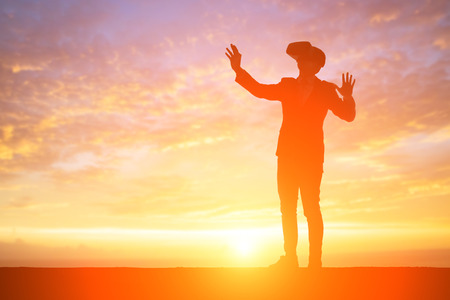silhouette of businessman wear vr with sunset