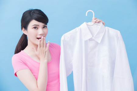 house take clean shirt and feel surprise on the blue background Stock Photo