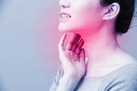 women with thyroid gland problem on the blue background Stok Fotoğraf - 98377224