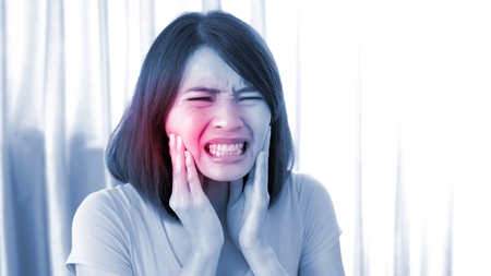 woman feel bad with toothache in the home Stock fotó