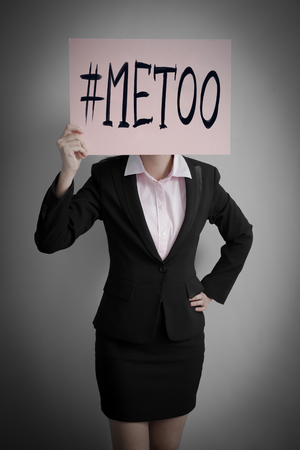 business woman take me too billboard on gray background Stock Photo