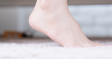 beauty woman use cream with foot at home Stock Photo