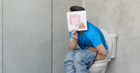 man take intestine billboard with colorectal cancer on the toilet