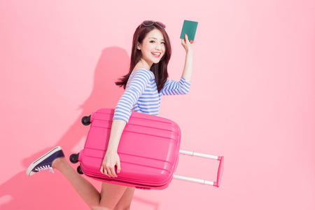 woman take luggage case and passport with travel concept Imagens