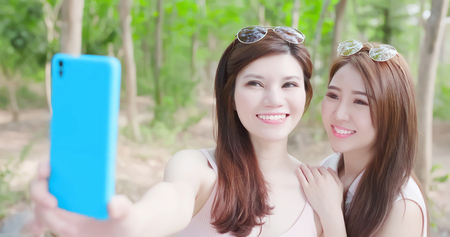 two beauty women wear brace and retainer for teeth selfie happily
