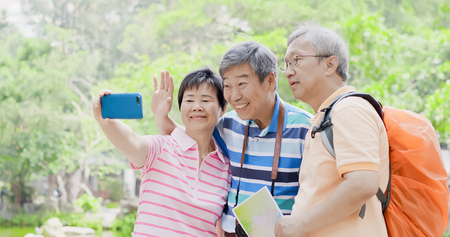 old travel people selfie happily in the park