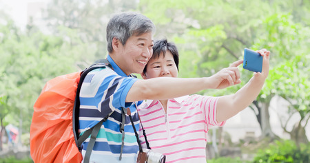 old couple selfie happily and go travel in the park