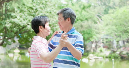 old couple feel enjoy and dance in the park 版權商用圖片