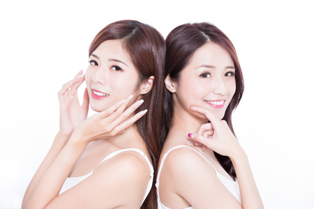two beauty skincare woman with health teeth on the white background