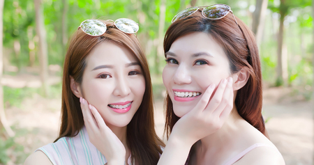 two beauty women wear brace and retainer for teeth smile happily Stock Photo