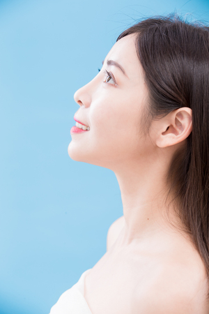 beauty woman profile look somewhere on the blue background Stock Photo