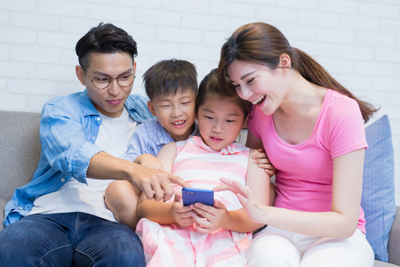 family use phone watch movie happily at home