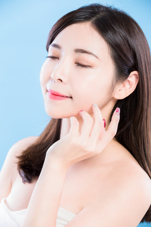 beauty skincare woman feel relax and close eyes on the blue background Stock Photo